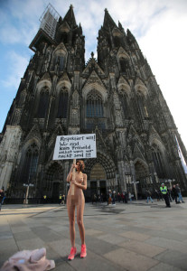 Swiss artist protests naked in Cologne. Image by Oliver Berg (PAP)